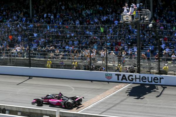 Helio Castroneves Celebrates His Record-tying Fourth Indy 500 Win